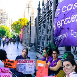 Women of La Casa del Encuentro sit infront of Congress, manifesting for women's rights and safety.