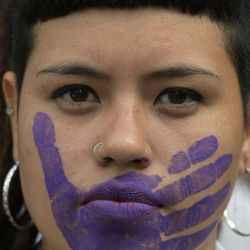 A woman takes part in a protest on the International Day for the Elimination of Violence against Women in Buenos Aires