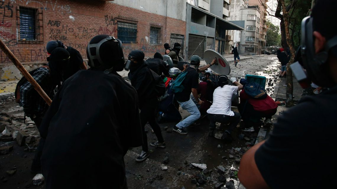 Anti-government demonstrators clash with police during protests in Santiago, Chile, Friday, November 22, 2019. It's been nearly five weeks since the most potent civil unrest in Chile's recent history broke out.