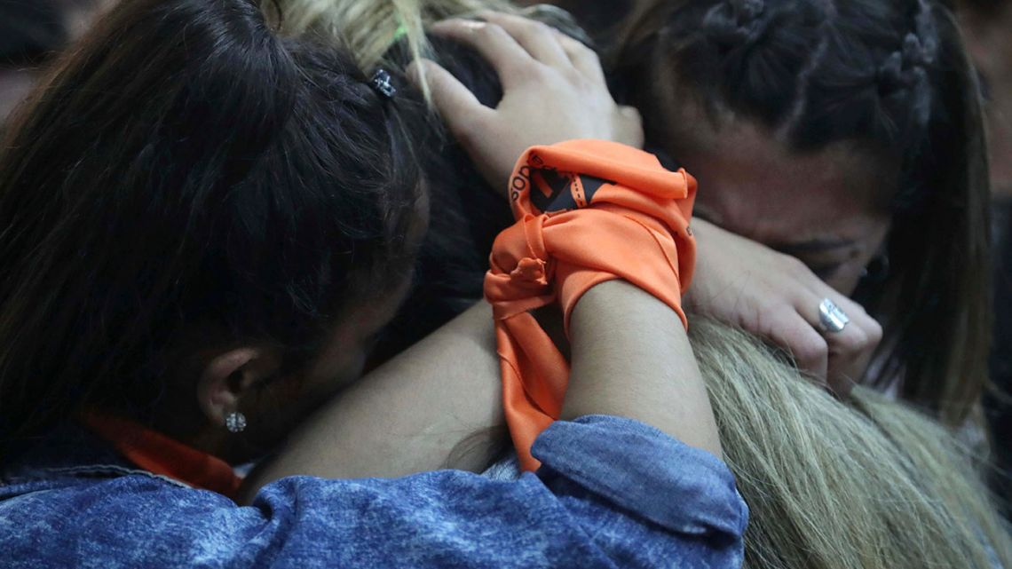 Victims and relatives of victims from the Antonio Próvolo Institute for Deaf and Hearing Impaired Children, embrace after hearing a guilty verdict for their abusers, in Mendoza, Argentina, Monday, November 25, 2019.