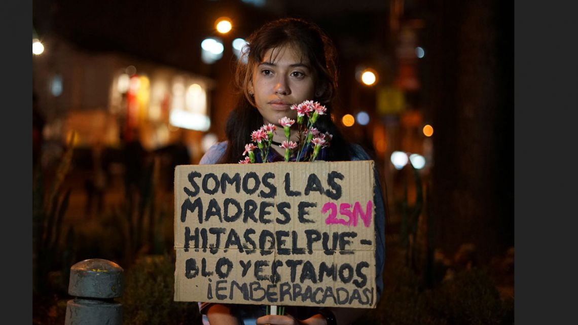Ana Maria Moya takes part in a march for International Day for the Elimination of Violence against Women, in Bogota.
