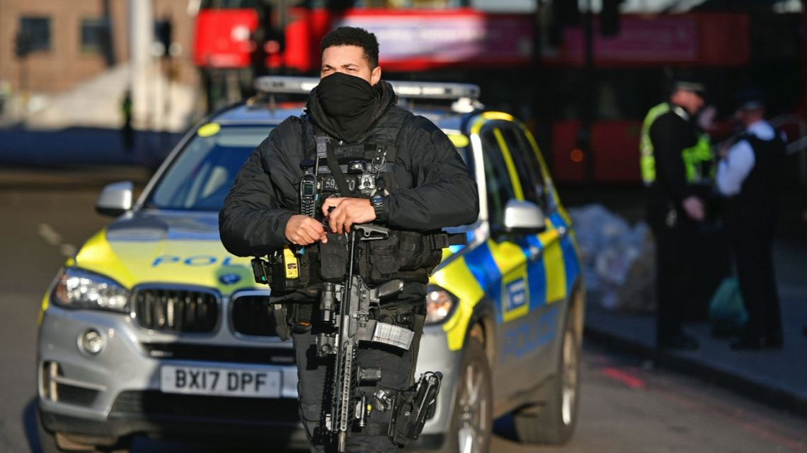 Armed police and emergency services at the scene of an incident on London Bridge in central London following a police incident, Friday, Nov. 29, 2019.