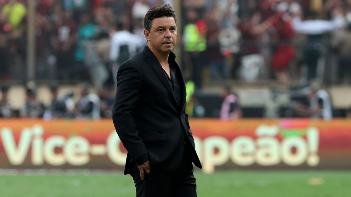 Marcelo Gallardo stands on the pitch after River Plate's dramatic defeat to Flamengo in the Copa Libertadores final.