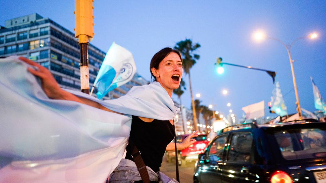 Supporters of Luis Lacalle Pou celebrate in Montevideo after his rival in the presidential race conceded.
