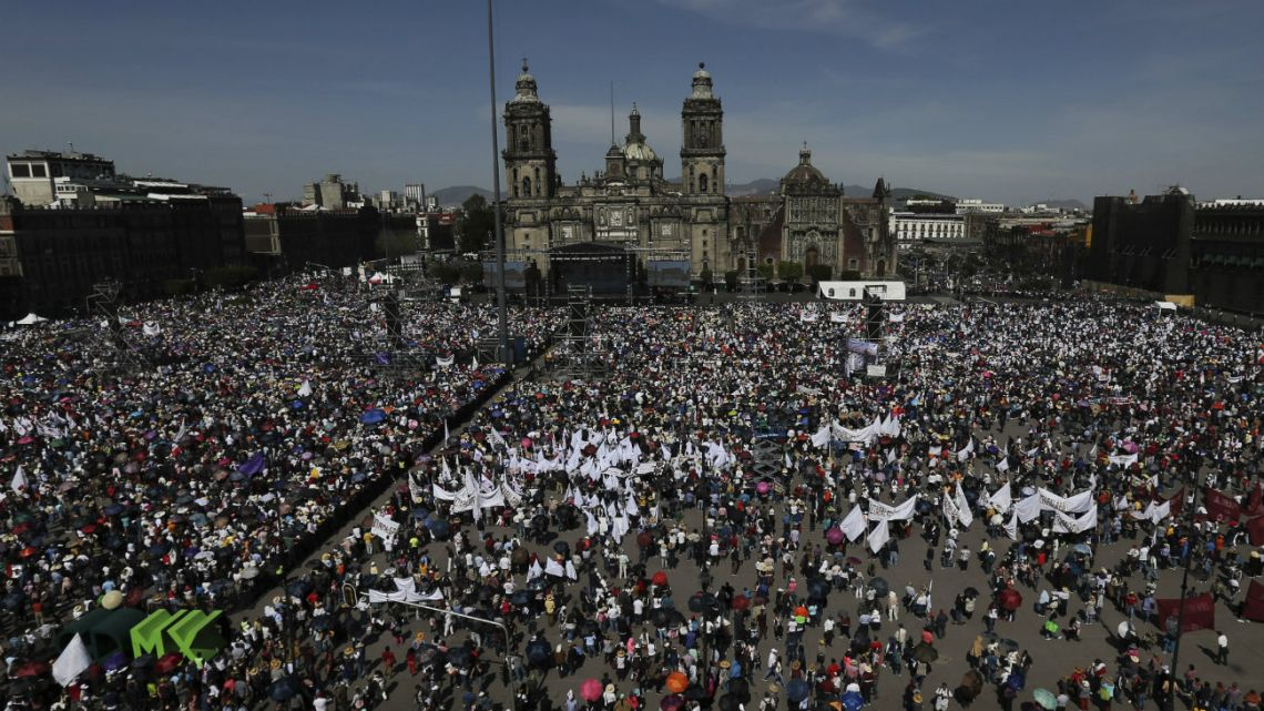 Supporters of Mexico's President Andres Manuel Lopez Obrador gather in the capital's main plaza, at the Zocalo, to join the president in commemorating his one year anniversary in office, in Mexico City.