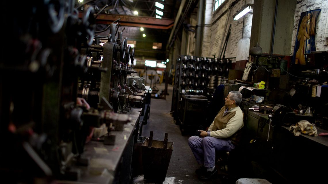 Worker José Esquivel takes a brief break inside the Work Cooperative Los Constituyentes Limited metallurgical plant, which was formed by workers in response to the 2001 economic crisis, in Buenos Aires, Argentina.