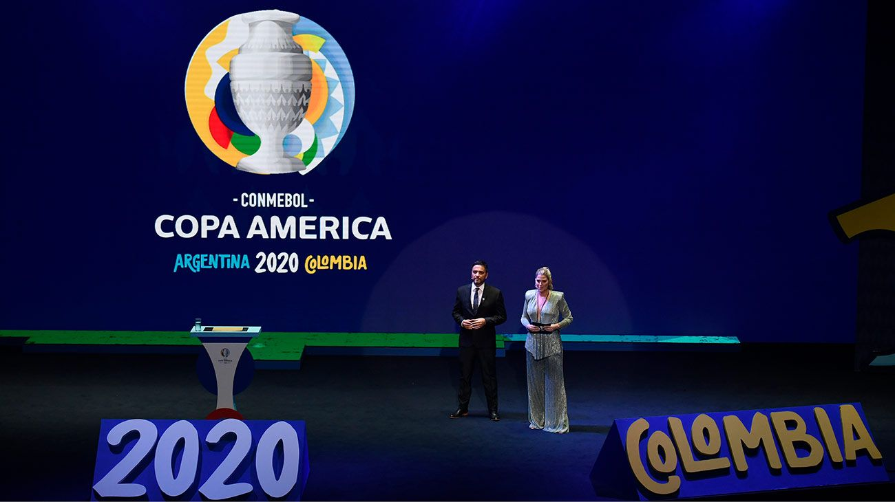 Sports journalists Andrea Guerrero from Colombia and Juan José Buscaglia from Argentina present the draw of the Copa América 2020 football tournament at the Convention Centre in Cartagena, Colombia, on December 3, 2019. The Copa América 2020 football tournament will be hosted jointly by Argentina and Colombia next year, from June 12 to July 12. Asian champions Qatar and previous winner Australia will participate as invited guest teams.