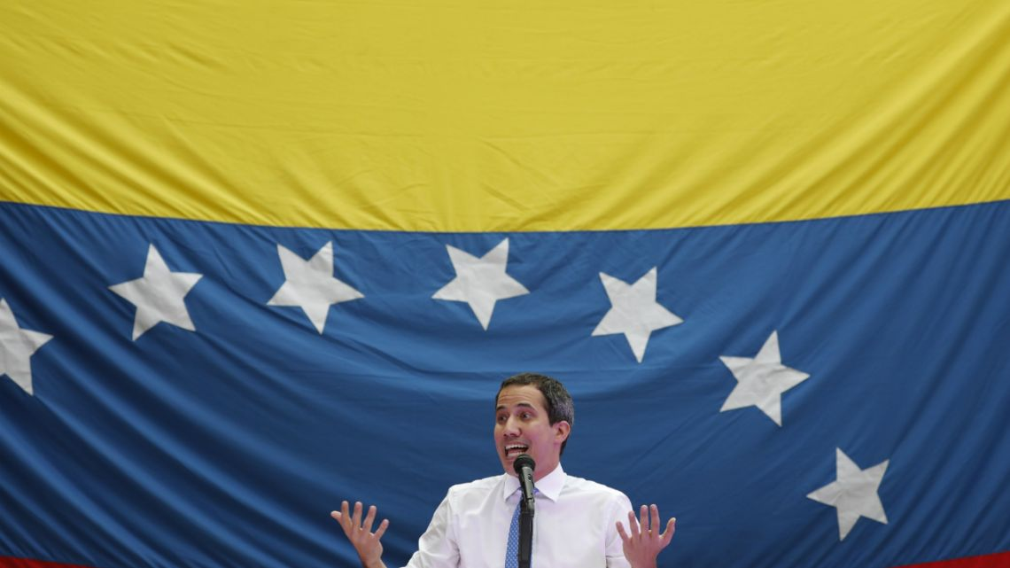 opposition leader and self-proclaimed interim President Juan Guaido speaks during a citizen assembly at a square in the neighborhood of El Paradiso in Caracas, Venezuela