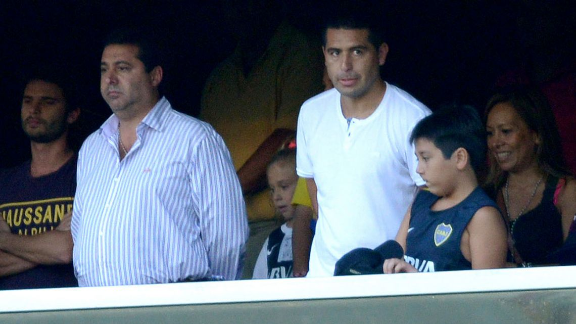 In this 2013 file photo, Boca Juniors' then-player Juan Román Riquelme and president Daniel Angelici watch a match at La Bombonera. The club holds elections on December 8.