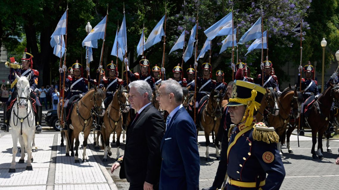Cuban President Miguel Díaz-Canel (left), accompanied by Argentine Vice-Foreign Minister Gustavo Zlauvinen, takes part in a wreath-laying ceremony to pay homage to Argentine national hero General José de San Martín, at San Martín Square in Buenos Aires, on December 9, 2019.