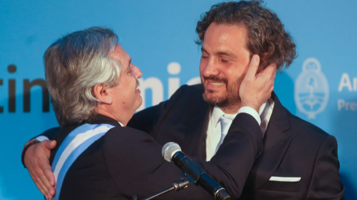 New Cabinet Chief Santiago Cafiero and President Alberto Fernández embrace after the former is sworn-in as an official.