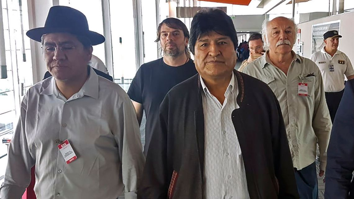 Bolivian ex-President Evo Morales (centre) and Bolivian former Foreign Minister Diego Pary Rodriguez (left)) walking upon their arrival at Ezeiza international airport in Buenos Aires on December 12.