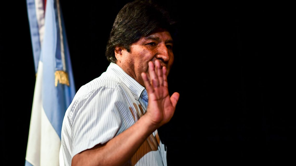 Bolivia's ex-President Evo Morales waves as he arrives for a press conference in Buenos Aires on December 17, 2019.