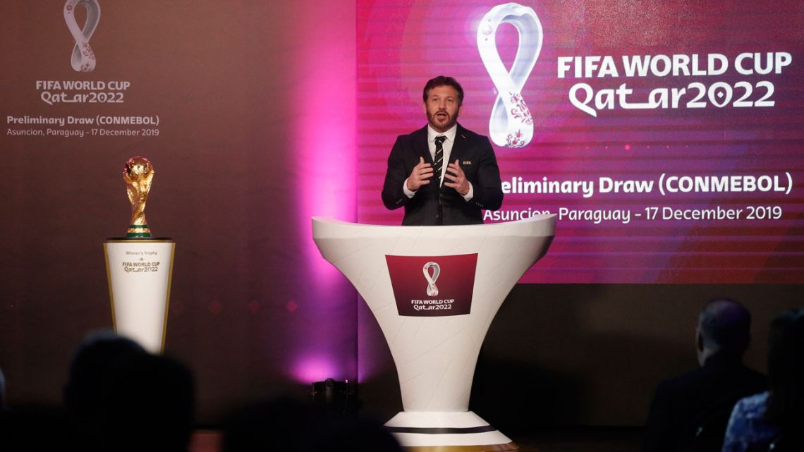 Alejandro Domínguez, head of the South American football's governing body CONMEBOL, presents the draw for Qatar 2022 South American qualifiers in Asunción, Paraguay, Tuesday, December 17, 2019.