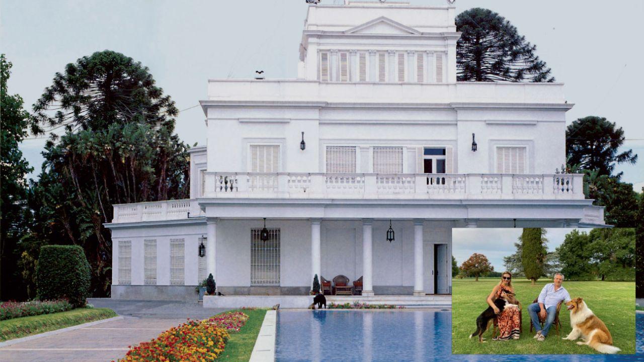 Un amplio parque y la fachada principal de la mansión, con un espejo de agua. Además, el estudio, la huerta orgánica y la cancha profesional de tenis.   Foto:Cedoc