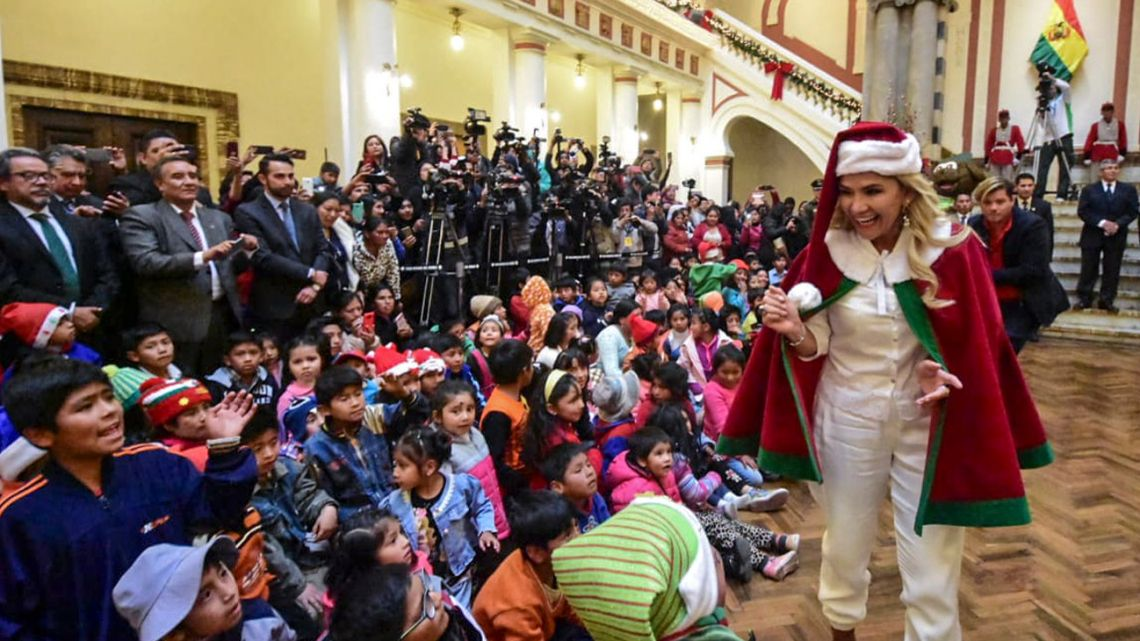 Bolivian interim president Jeanine Añez dressed as Santa Claus during a Christmas celebration at Quemado presidential palace in La Paz, on December 17, 2019.