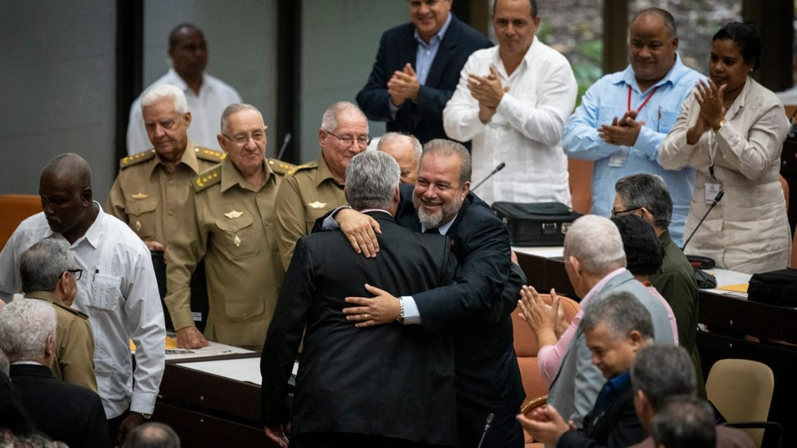 Cuban Prime Minister Manuel Marrero Cruz embraces Cuba's President Miguel Díaz-Canel during the closing session at the National Assembly of Popular Power in Havana, Cuba, Saturday, December 21, 2019.