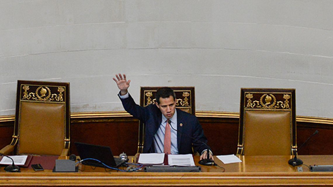 In this December 17, 2019 photo, Venezuelan opposition leader and self-proclaimed interim president of Venezuela Juan Guaidó speaks during an extraordinary session at the National Assembly in Caracas, Venezuela.