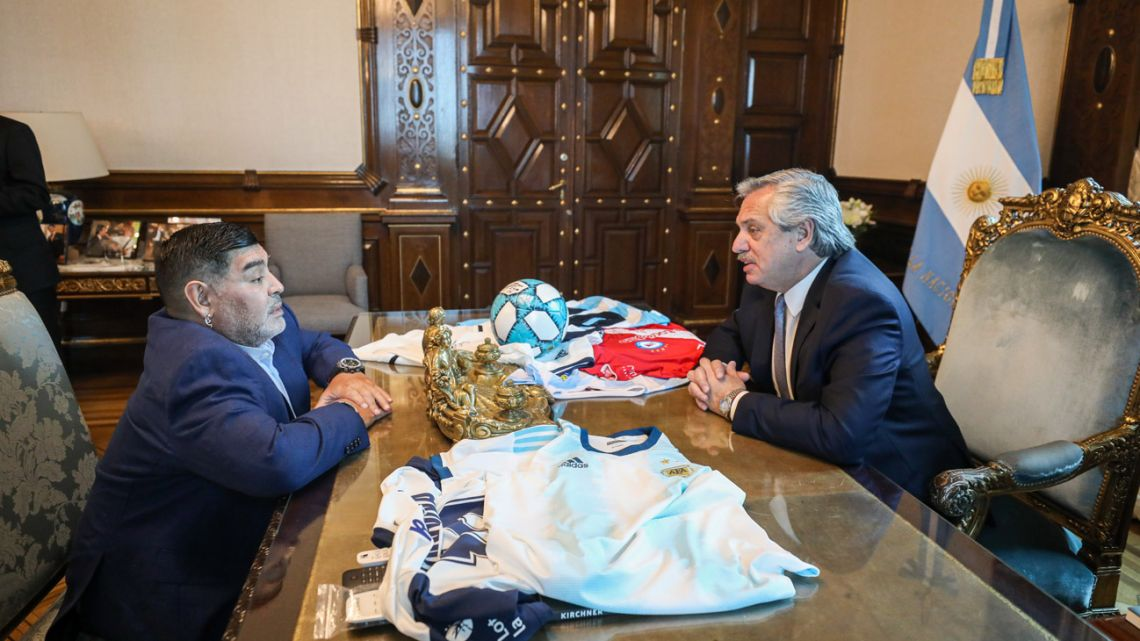 President Alberto Fernández (right) holds a private meeting with Diego Maradona at the Casa Rosada in Buenos Aires, on December 26, 2019.