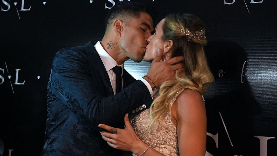 Footballer Luis Suárez and his wife Sofía Balbi kiss at their second wedding in Uruguay