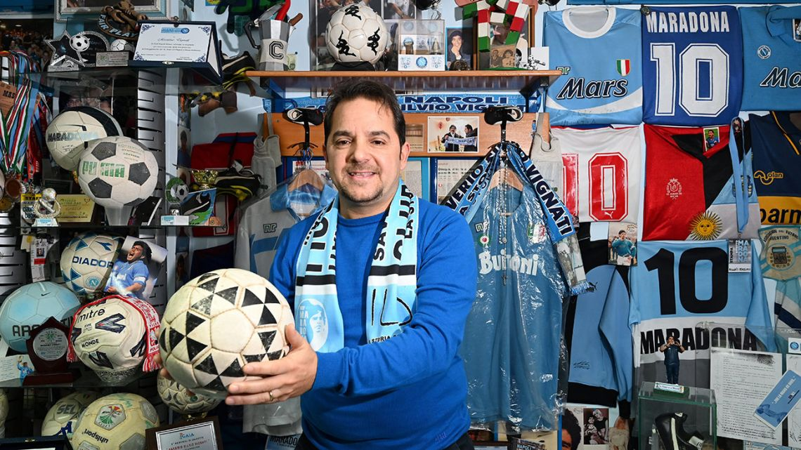 Massimo Vignati plays with a match ball once used by Diego Maradona at his 'Maradona museum' in Naples.