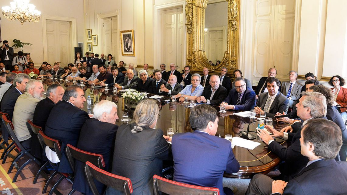 President Alberto Fernández meets with business leaders and unionists at the Casa Rosada.