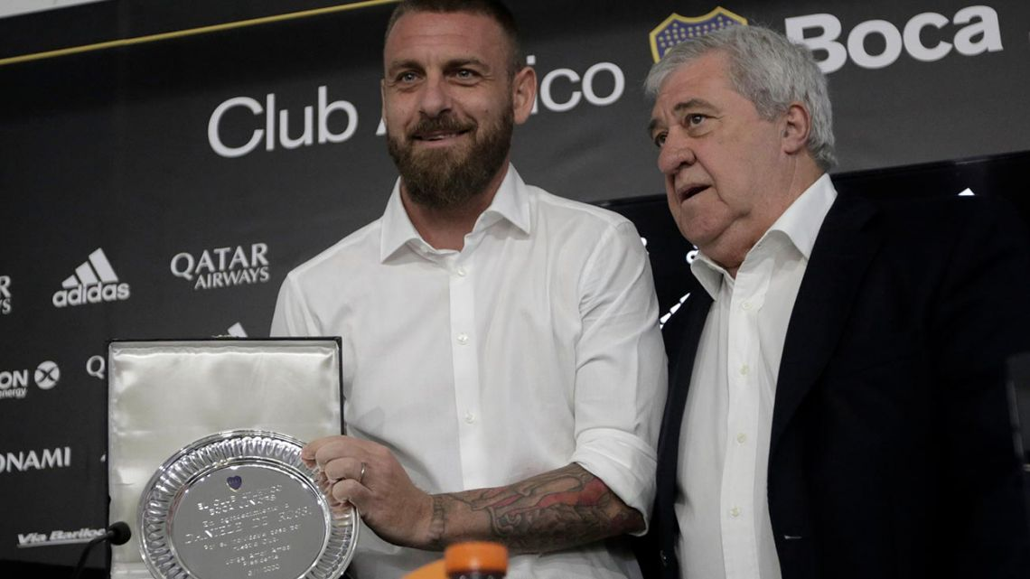 Veteran former Italy international Daniele De Rossi (left) receives a plate from Boca Juniors President Jorge Ameal, during a press conference in Buenos Aires, Argentina, on December 6, 2020.