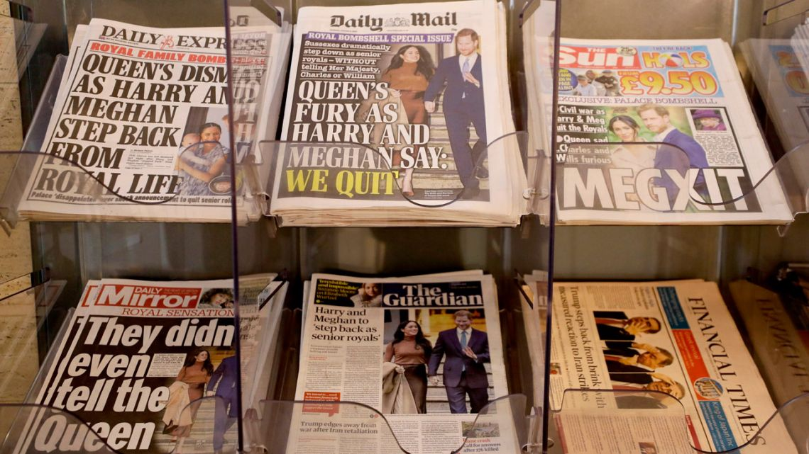 "Newspapers are seen for sale in London, Thursday, January 9, 2020. In a statement Prince Harry and his wife, Meghan, said they are planning ""to step back"" as senior members of the royal family and ""work to become financially independent."""