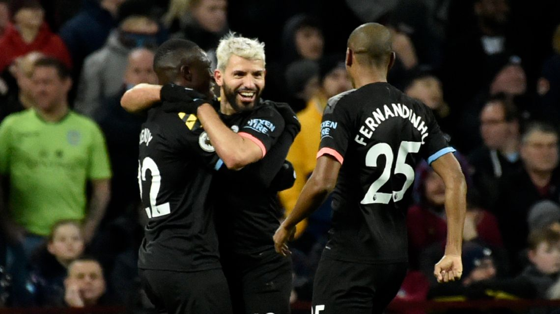 Manchester City's Sergio Agüero celebrates with teammates after scoring his side's third goal during the English Premier League match between Aston Villa and Manchester City at Villa Park.