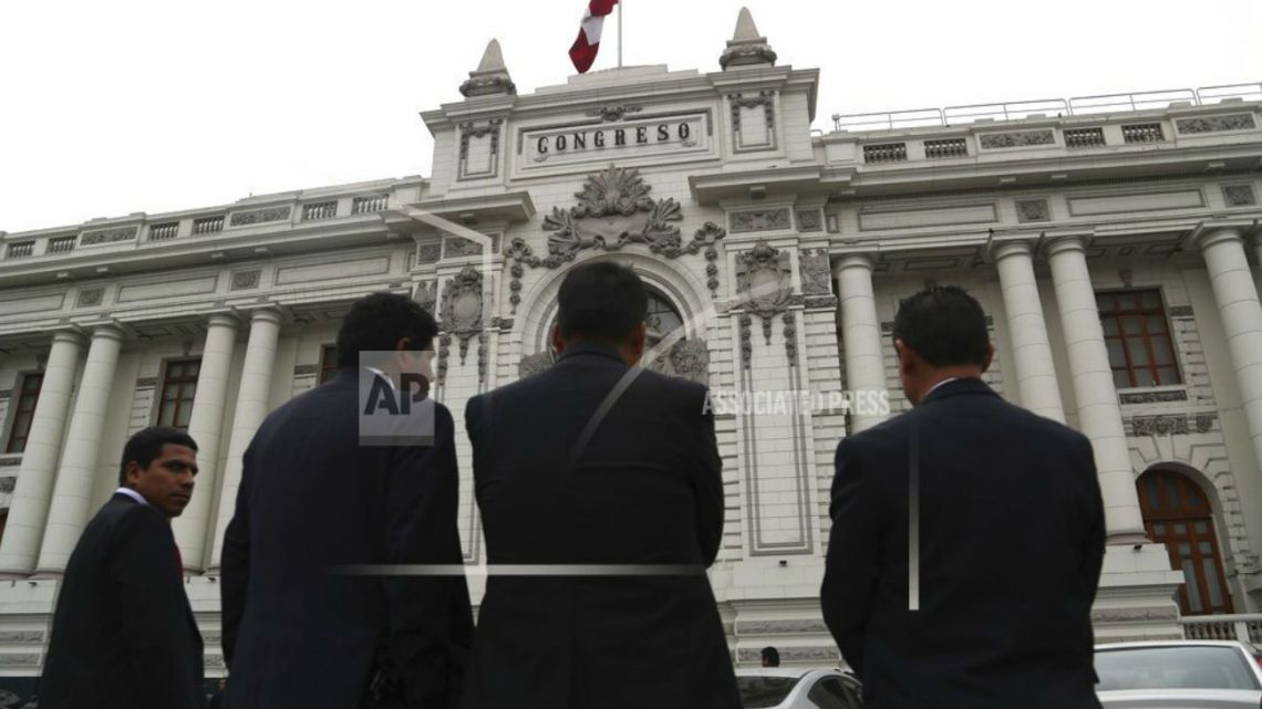 Security officers stand outside Peru's Congress building on the day Vizcarra dissolves the branch.