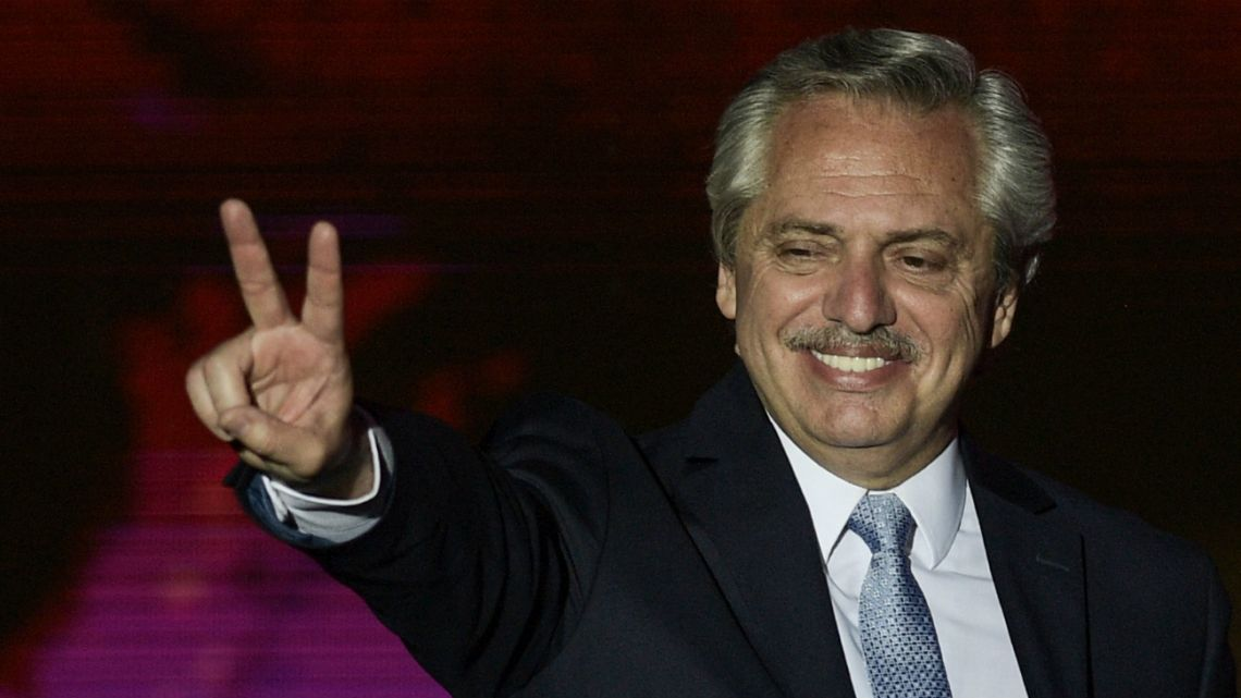 President Alberto Fernandez flashes the victory sign during the inauguration ceremony at Plaza de Mayo square in Buenos Aires on December 10, 2019
