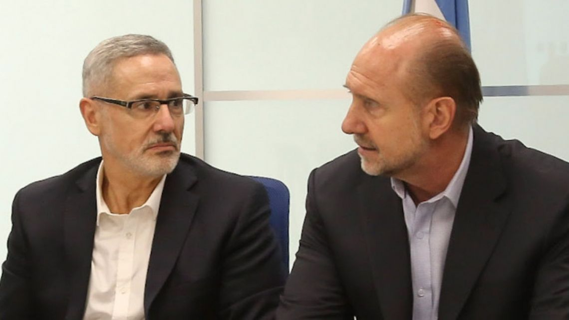 Santa Fe Province Govenor Omar Perotti (right), pictured with his provincial security chief Marcelo Saín.