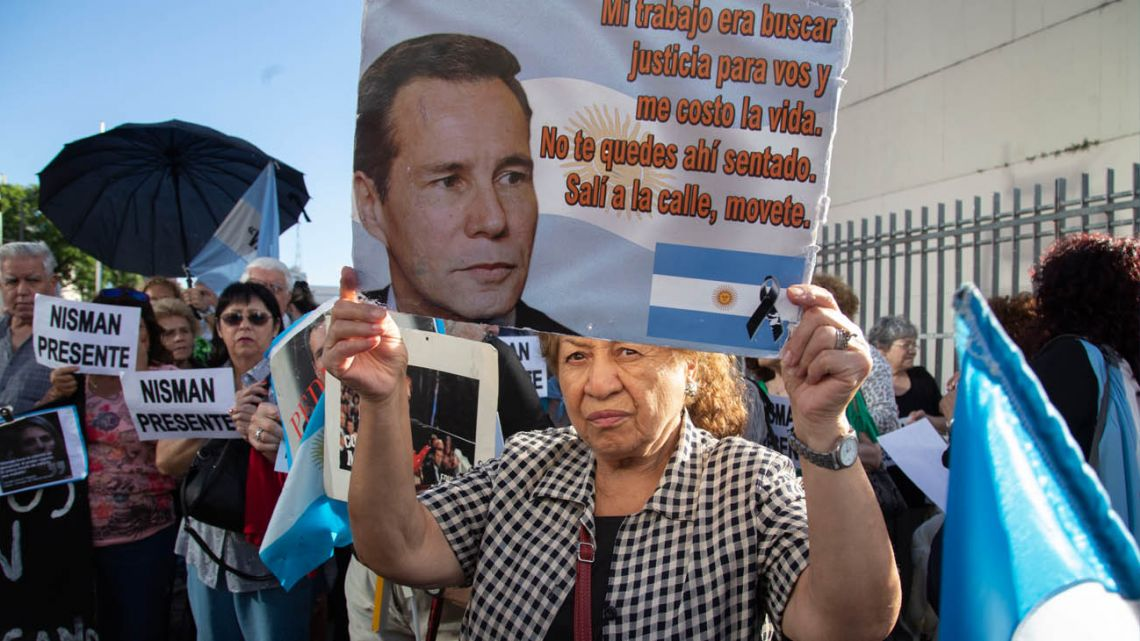 A protester holds up a sign at a rally demanding justice for Alberto Nisman in 2018.