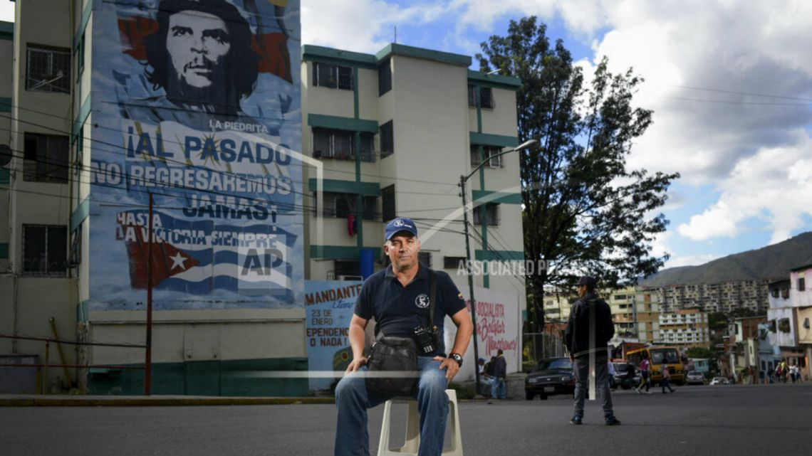 "David Romero, a 46-year-old militant with the ruling United Socialist Party of Venezuela who founded the pro-government ""Colectivo Salvador Allende"" organization, poses for a portrait in the 23 de Enero neighborhood of Caracas, Venezuela."