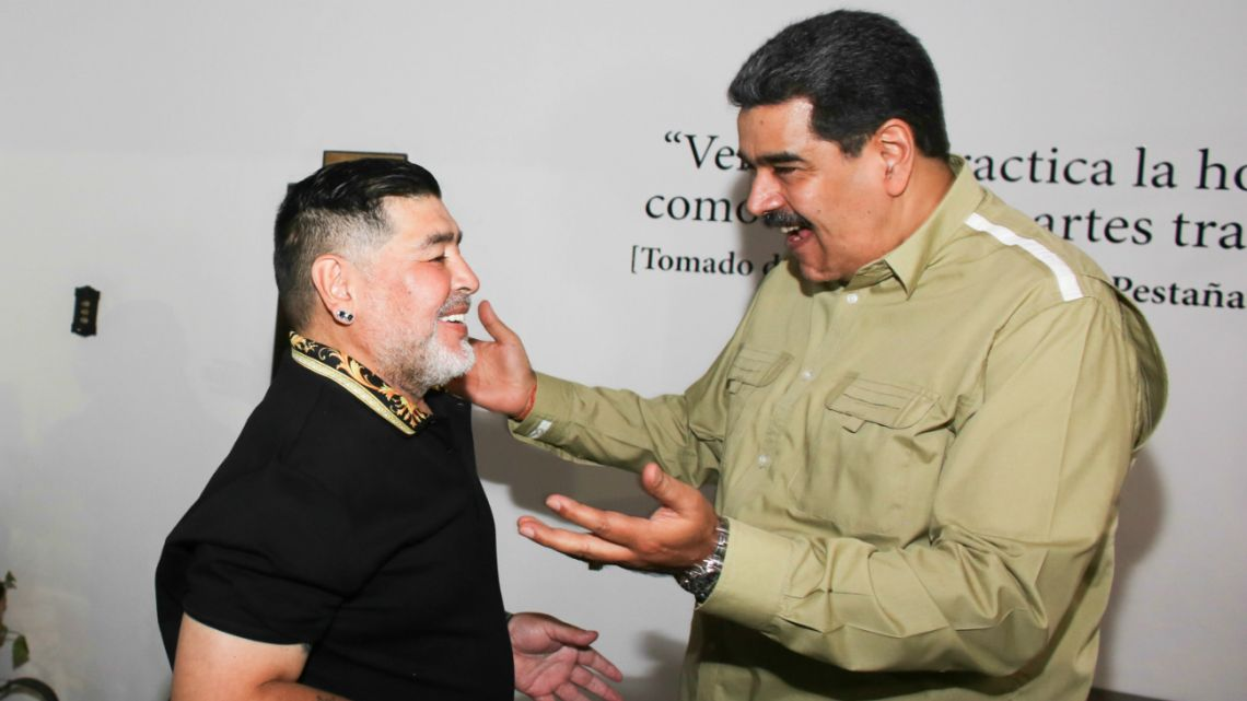 Venezuela's President Nicolas Maduro (Right) greeting Argentina's former football player Diego Armando Maradona (Left) at the Miraflores Palace in Caracas, on January 21, 2020