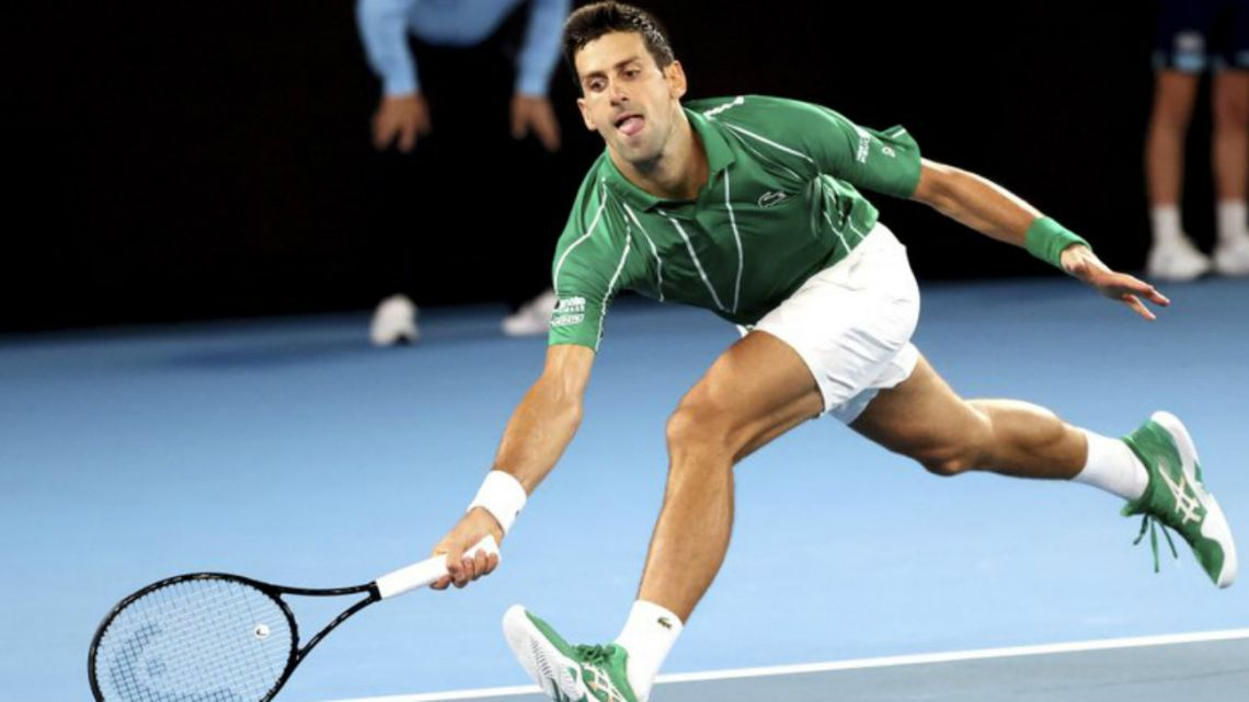 Serbia's Novak Djokovic reaches for a forehand return to Germany's Jan-Lennard Struff during their first round singles match the Australian Open tennis championship in Melbourne, Australia, Monday, Jan. 20, 2020.
