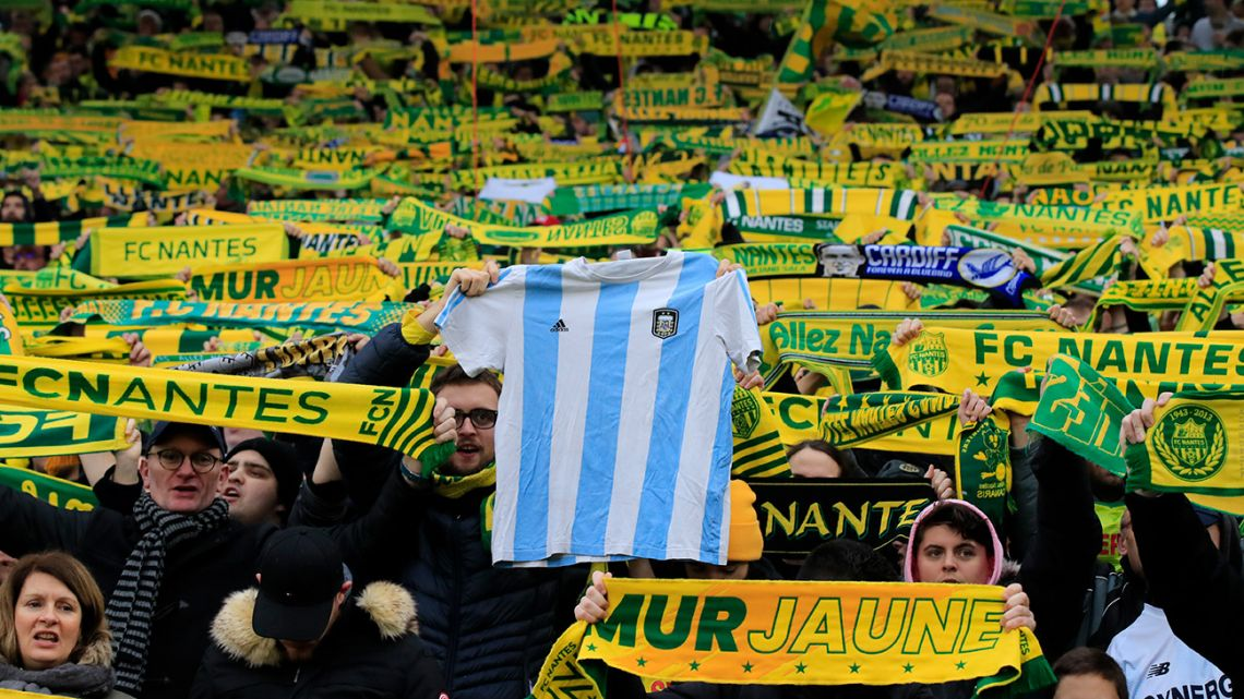 Nantes supporters hold an Albiceleste jersey to pay tribute to Emiliano Sala prior the French Ligue 1 match between Nantes against Bordeaux in Nantes, western France, Sunday, Jan. 26, 2020.