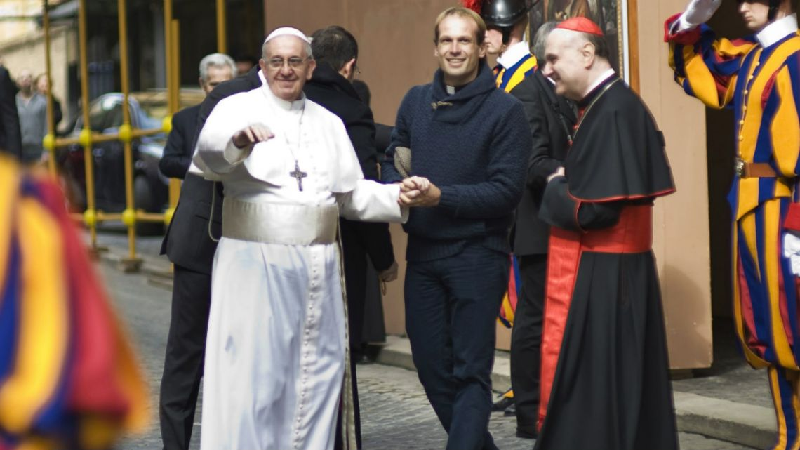 Pope Francis is flanked by Gonzalo Aemilius as he greets faithful at the Vatican