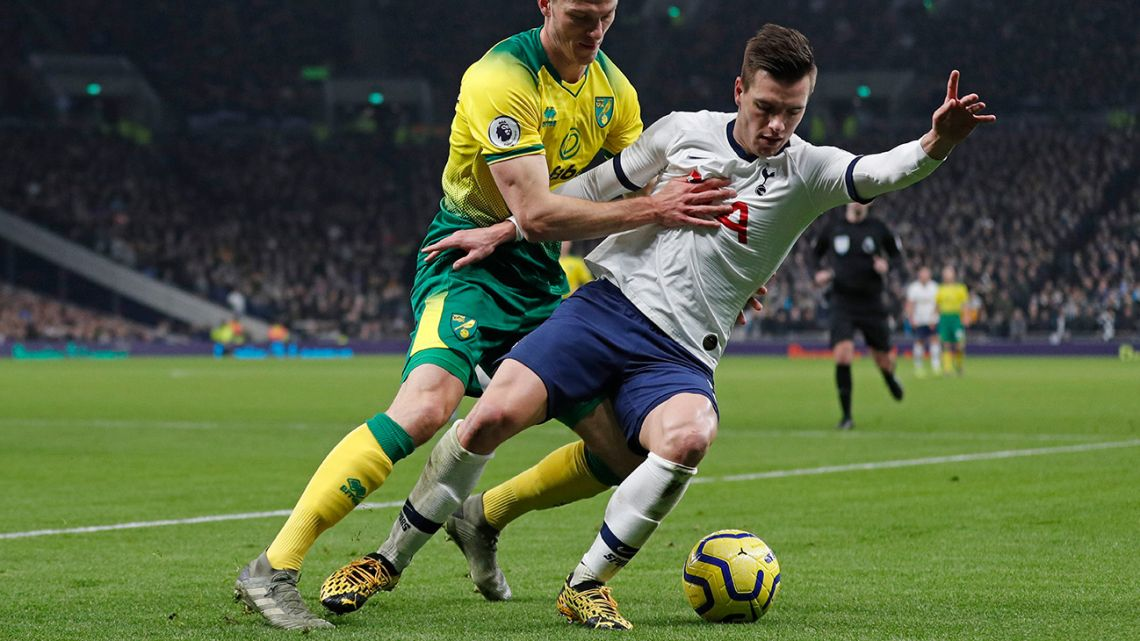 Tottenham Hotspur's Argentine midfielder Giovani Lo Celso shields the ball from Norwich City's German defender Christoph Zimmermann.