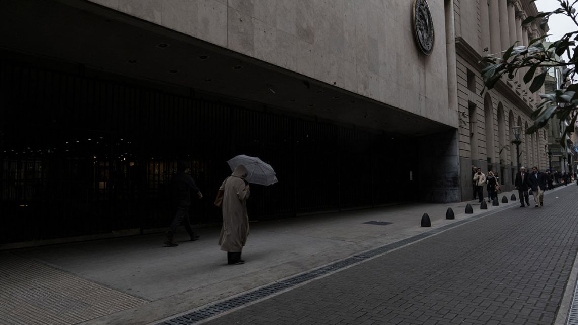 A man walks through the financial district in Buenos Aires.