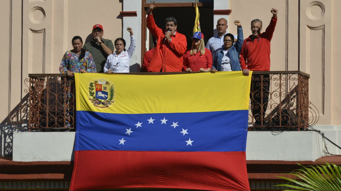 Venezuelan President Nicolas Maduro speaks to supporters from a balcony at Miraflores presidential palace.