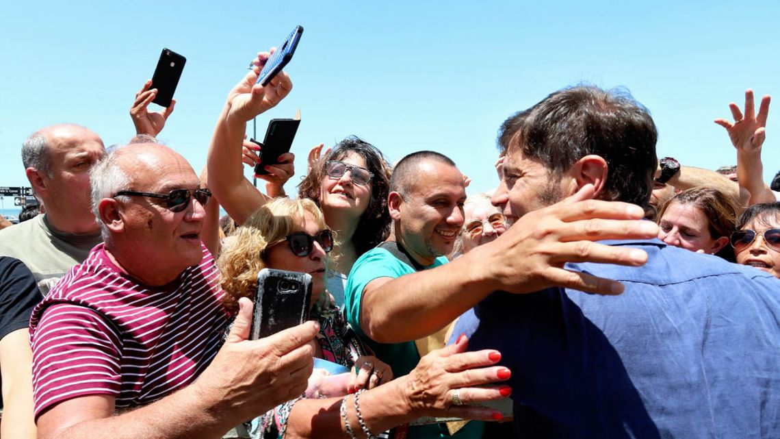 Axel Kicillof greets supporters in La Plata.