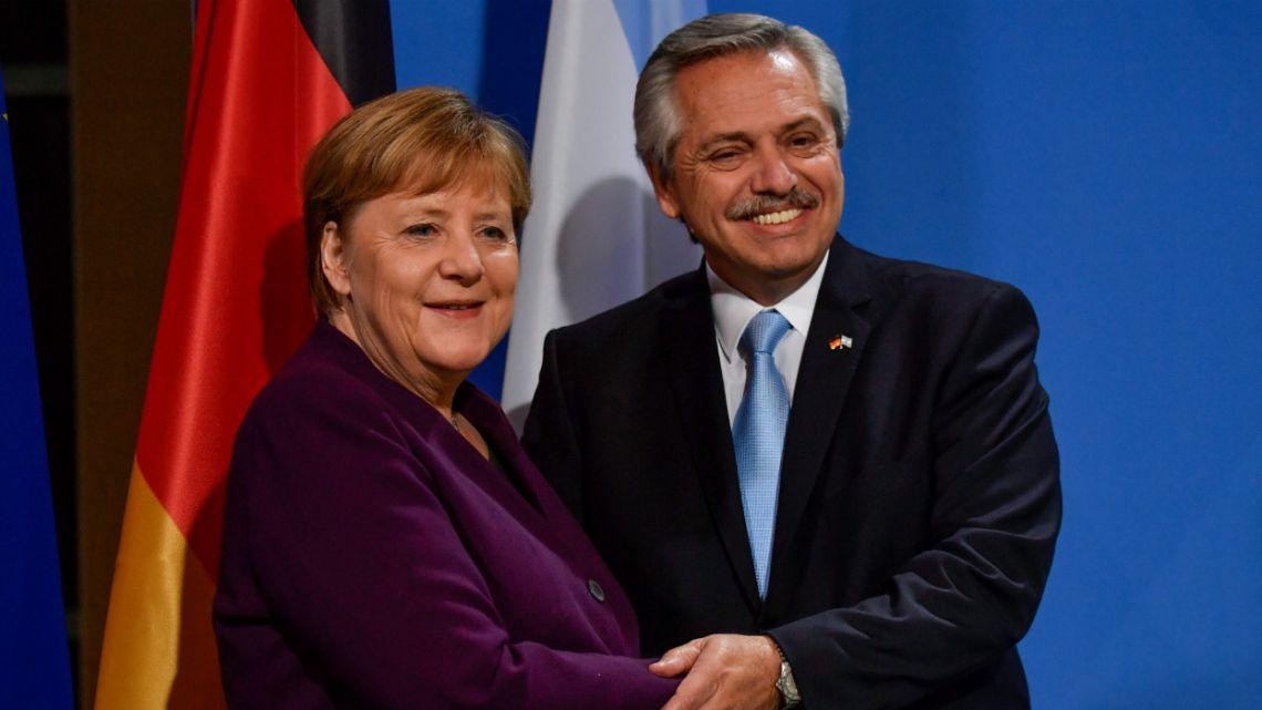 Alberto Fernández greets German Chancellor Angela Merkel.