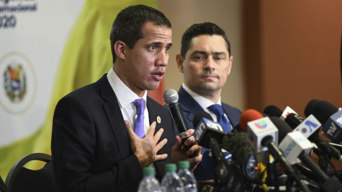 Venezuela's interim President Juan Guaidó speaks to the media after a rally in Miami.