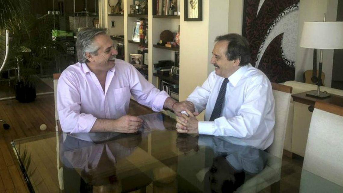 Alberto Fernández poses with Ricardo Alfonsín.