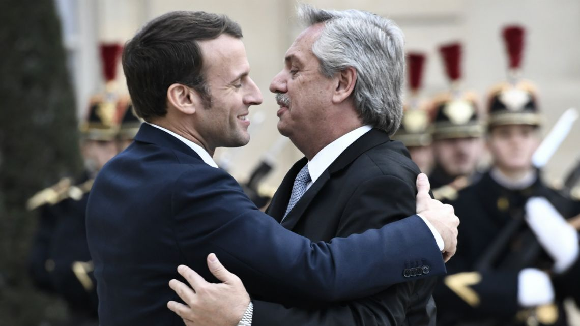 France's President Emmanuel Macron (left) welcomes Argentina's President Alberto Fernández (right) prior to their meeting at the Elysee presidential Palace in Paris on February 5, 2020.