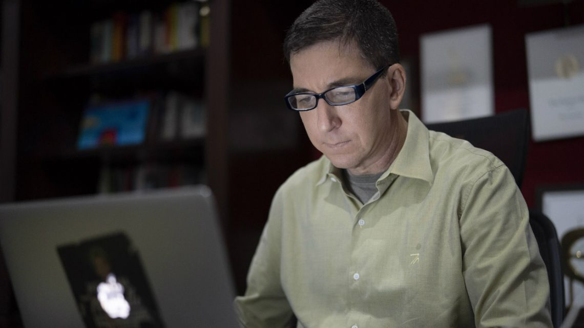 US journalist Glenn Greenwald checks his news website at his home in Rio de Janeiro, Brazil.