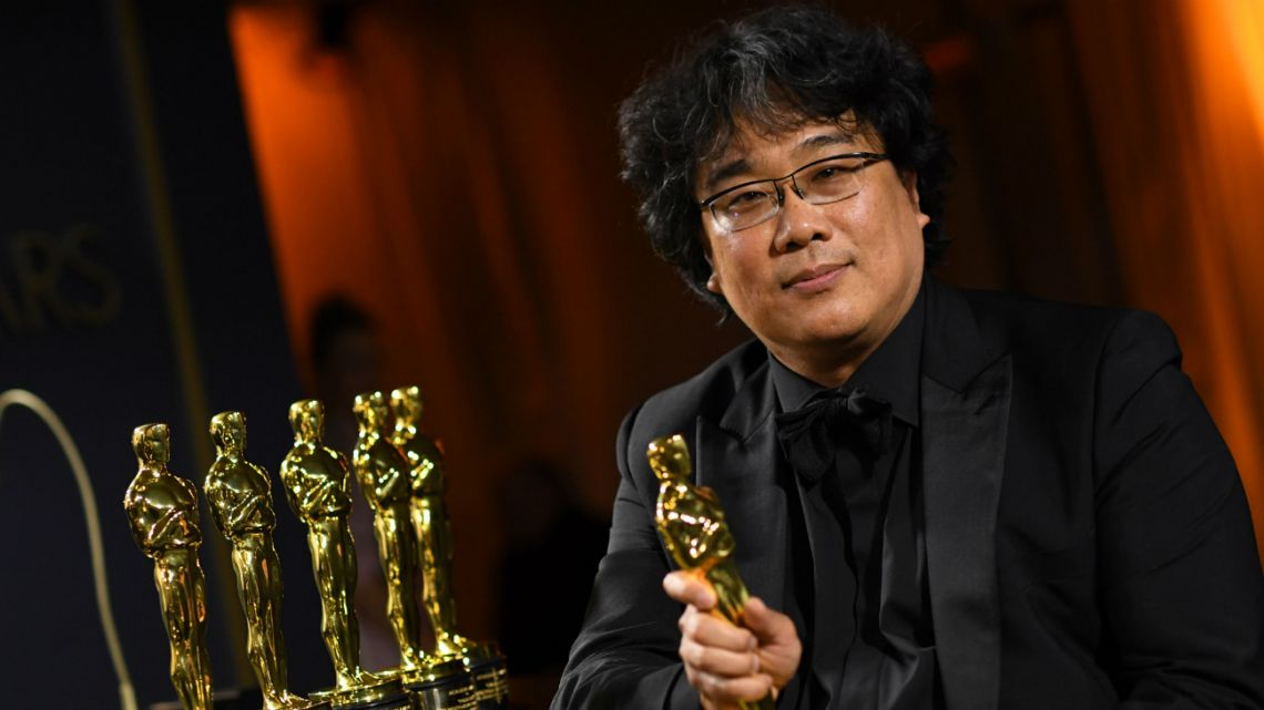 South Korean film director Bong Joon Ho poses with his engraved awards as he attends the 92nd Oscars Governors Ball at the Hollywood & Highland Center in Hollywood, California on February 9, 2020.