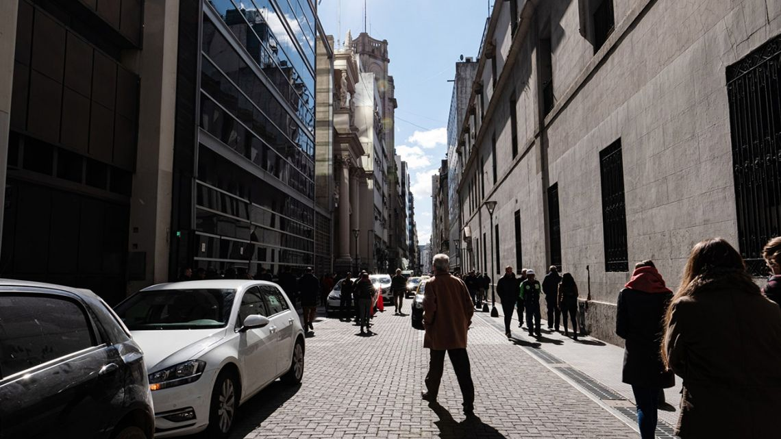 Pedestrians walk through Buenos Aires' financial district.