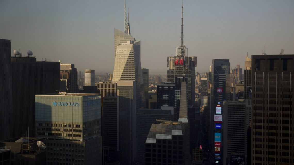 The Barclays Capital building, from left, Bank of America Tower, and 4 Times Square building, displaying the Hennes & Mauritz AB (H&M) logo, stand in New York, U.S., on Monday, May 4, 2015